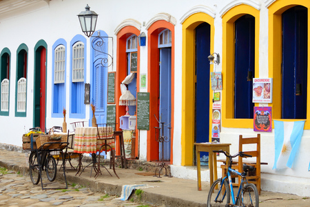 cobbled: PARATY, BRAZIL - OCTOBER 14, 2014: Restaurant in the Old Town of Paraty (state of Rio de Janeiro). The colonial town dates back to 1667 and is considered for inclusion on UNESCO World Heritage List.