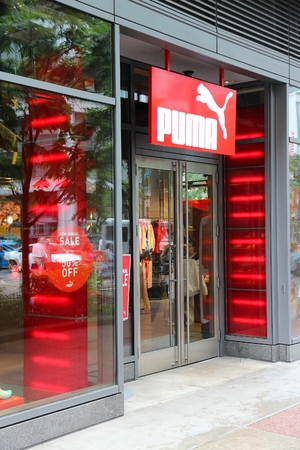 magnificent mile: CHICAGO, USA - JUNE 26, 2013: Puma sportswear store at Magnificent Mile in Chicago. The Magnificent Mile is one of most prestigious shopping districts in the United States.