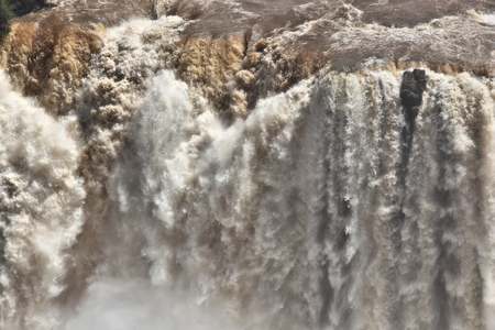 waterfall  dirty: Muddy water in Iguazu Falls. Brazil nature.