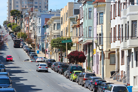 nob hill: SAN FRANCISCO, USA - APRIL 8, 2014: People drive in the steep streets of San Francisco, USA. San Francisco is the 4th most populous city in California (837,442 people in 2013).