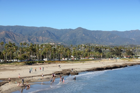 barbara: SANTA BARBARA, USA - APRIL 6, 2014: People visit Chase Palm Park in Santa Barbara, California. Santa Barbara is a popular tourist destination with more than 6 million visitors in 2012.