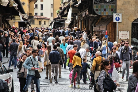 visitors area: FLORENCE, ITALY - MAY 1, 2015: Crowd of people visits Ponte Vecchio in Florence, Italy. Italy is visited by 47.7 million tourists a year (2013). Editorial