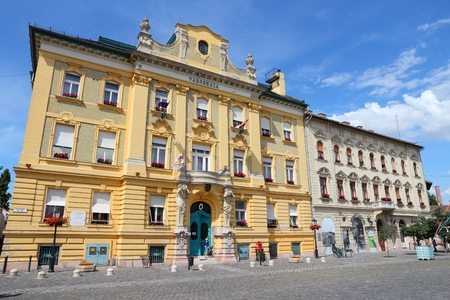 obuda: BUDAPEST, HUNGARY - JUNE 21, 2014: Man exits Varoshaza, Town Hall of Obuda district  in Budapest. Budapest is the largest city in Hungary and 9th largest in the EU (3.3 million people). Editorial