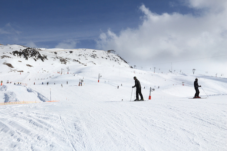 ski runs: VALLOIRE, FRANCE - MARCH 24, 2015: Skiers enjoy the snow in Galibier-Thabor station in France. The station is located in Valmeinier and Valloire and has 150km of ski runs.