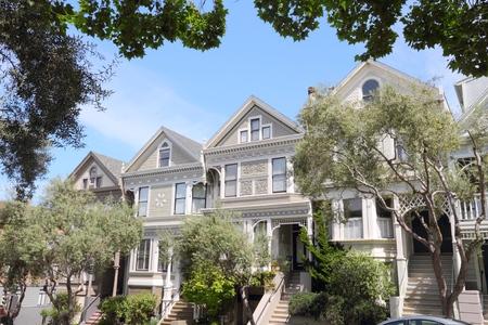 row of houses: San Francisco - Victorian row houses in Western Addition neighborhood. Stock Photo