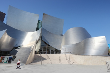 frank   gehry: LOS ANGELES, USA - APRIL 5, 2014: Person visits Walt Disney Concert Hall in Los Angeles. The famous landmark was designed by Frank Gehry. Editorial