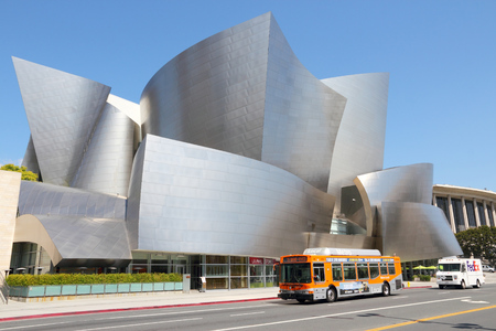 frank: LOS ANGELES, USA - APRIL 5, 2014: City bus drives by Walt Disney Concert Hall in Los Angeles. The famous landmark was designed by Frank Gehry. Editorial