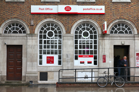 LONDON, UK - MAY 14, 2012: People visit Post Office in London. Royal Mail was founded in 1516 and employs 150,000 people (2013).