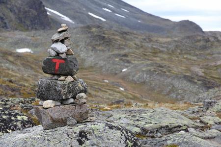 besseggen: Norway nature - Jotunheimen National Park. Besseggen ridge trail marking cairns.
