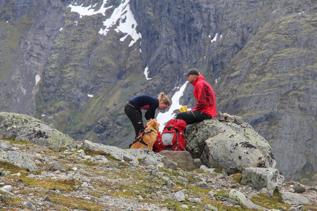 jotunheimen national park: JOTUNHEIMEN, NORWAY - AUGUST 1, 2015: People rest at Besseggen trail in Jotunheimen National Park, Norway. Norway had almost 5 million foreign visitors in 2011.