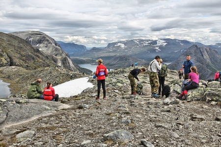 gjende: JOTUNHEIMEN, NORWAY - AUGUST 1, 2015: People rest at Besseggen trail in Jotunheimen National Park, Norway. Norway had almost 5 million foreign visitors in 2011.