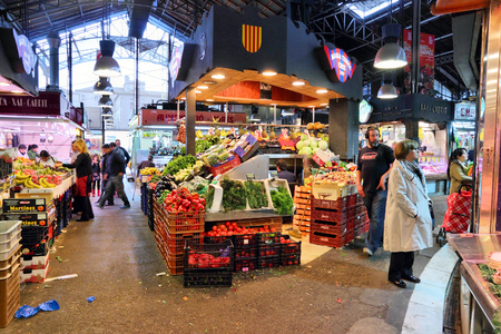 BARCELONA, SPAIN - NOVEMBER 6, 2012: People visit Boqueria market in Barcelona, Spain. The marketplace in Ciutat Vella district dates back to year 1217. Editorial