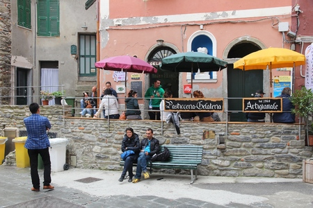 vernazza: VERNAZZA, ITALY - APRIL 26, 2015: People visit gelateria (ice cream shop) Vernazza in Italy. It is part of Cinque Terre, a UNESCO World Heritage site established in 1997. Editorial