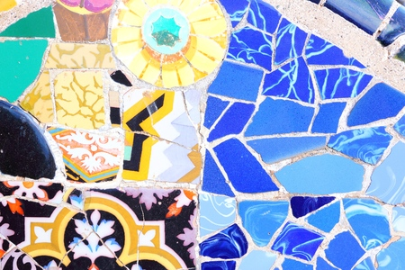 trencadis: BARCELONA, SPAIN - NOVEMBER 6, 2012: Mosaics in Park Guell in Barcelona, Spain. The landmark was built in 1900-14 and is part of the UNESCO World Heritage Site Works of Antoni Gaudi.