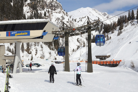 ski runs: GASTEIN VALLEY, AUSTRIA - MARCH 10, 2016: People visit Sportgastein ski resort in Austria. It is part of Ski Amade, one of largest ski regions in Europe with 760km of ski runs. Editorial