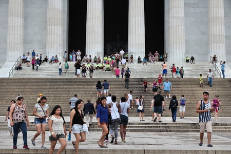 abraham lincoln: WASHINGTON, USA - JUNE 13, 2013: People visit Abraham Lincoln memorial in Washington. 18.9 million tourists visited capital of the United States in 2012. Editorial