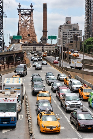congested: NEW YORK, USA - JULY 3, 2013: People drive in traffic from Queensboro Bridge in New York. New York is among most congested cities in America. In 2009 average American spent 34 hours in traffic jams. Editorial