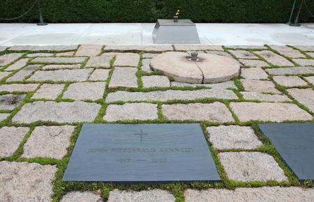 WASHINGTON, USA - JUNE 13, 2013: John Fitzgerald Kennedy grave at Arlington National Cemetery in Washington. JFK was the 35th President of the United States (1961-1963).