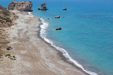 tou: Cyprus - Mediterranean Sea coast. Petra tou Romiou beach - Aphrodites Rock. Stock Photo