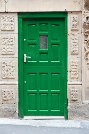 travel features: Green door in Manchester - city in North West England (UK).