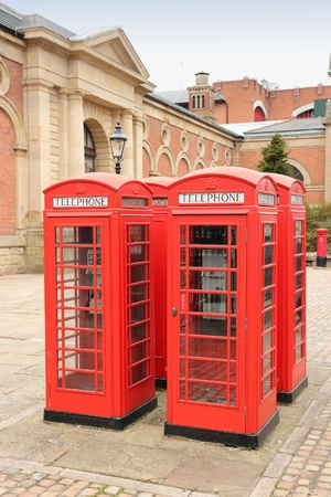 phonebooth: Bolton red telephone boxes. North West England, UK.