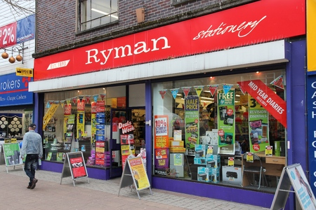 office supply: BOLTON, UK - APRIL 23, 2013: Person walks by Ryman Stationery store in Bolton, UK. Ryman is a UK stationery and office supply retail company with over 220 stores.