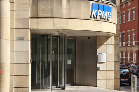 auditor: MANCHESTER, UK - APRIL 23, 2013: KPMG auditing company in Manchester, UK. KPGM is one of Big Four auditor companies. It had 23.4bn USD revenue and 155,000 employees in 2013. Editorial