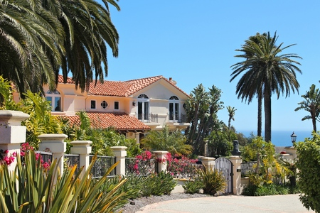 residential: MALIBU, UNITED STATES - APRIL 6, 2014: Luxury California residential home as seen from public road in Malibu, USA. Real estate rates in California have grown 105 percent since 1990. Editorial