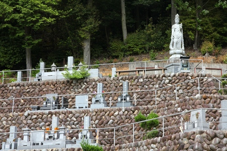 cremated: INUYAMA, JAPAN - MAY 3, 2012: Cemetery in Inuyama, Japan. As of 2007, 99.8 percent of Japanese deceased were cremated.
