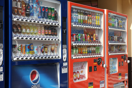 TOKYO, JAPAN - APRIL 12, 2012: Vending machines in Tokyo, Japan. Japan is famous for its vending machines, with more than 5.5 million machines nationwide.
