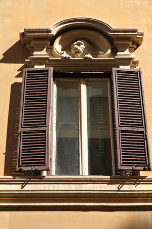 feature: Rome, Italy - architectural feature in historical building, old window.