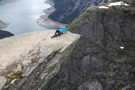 natural landmark: Tourist at Trolls Tongue - natural landmark in Norway.