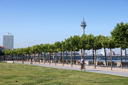 westfalen: DUSSELDORF, GERMANY - JULY 8, 2013: People ride bicycles in Dusseldorf, Germany. Dusseldorf is 7th most populous city in Germany with 604,000 people (1.2 million in urban area).