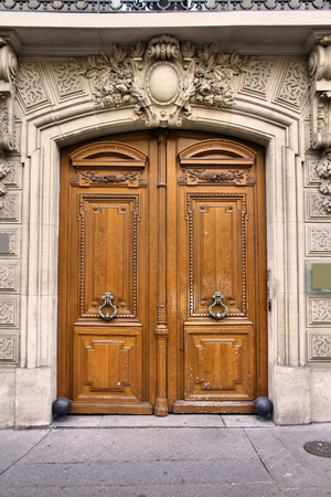 ornate door: Old ornate door in Paris, France - typical old apartment building. Stock Photo