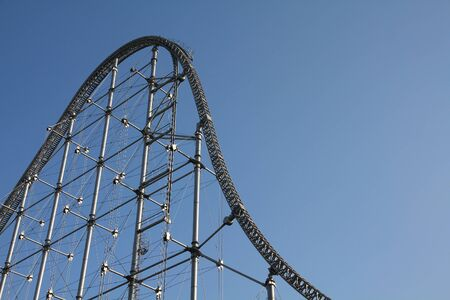 rollercoaster: Rollercoaster track in an amusement park. Steel structure.