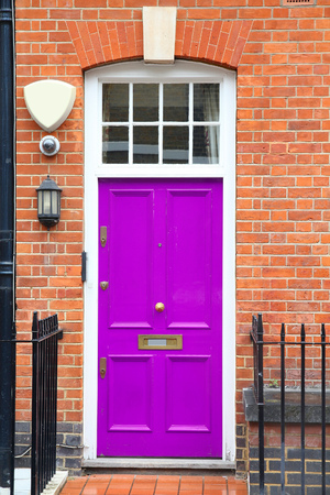 violet residential: Old door in London, UK - typical Georgian architecture feature.