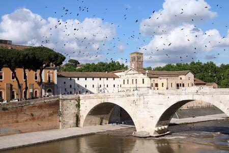 tevere: Rome - Isola Tiberina. River Tevere island bridge. Stock Photo