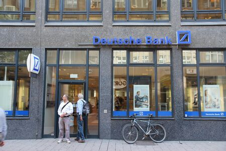 bank branch: HAMBURG, GERMANY - AUGUST 28, 2014: People visit Deutsche Bank branch in Hamburg. Deutsche Bank is one of largest banks in the world with 98,200 employees (2013). Editorial
