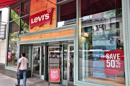 levis: CHICAGO, USA - JUNE 26, 2013: Man enters Levis store in Chicago. Levis is an American clothing company. It exists since 1853 and had USD 4.4bn revenue in 2010.