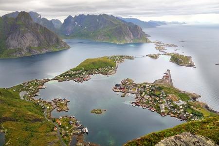 arctic zone: Lofoten archipelago in Norway. Reine fishing village in Moskenesoya island. Aerial view from Reinebringen hiking trail. Stock Photo