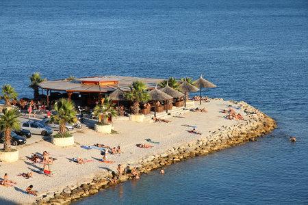 vacationers: SPLIT, CROATIA - JUNE 27, 2011: Vacationers enjoy the beach in Split, Dalmatia, Croatia. In 2011 11.2 million tourists visited Croatia, most of them in summer.