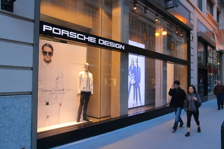 luxury goods: SAN FRANCISCO, USA - APRIL 8, 2014: People walk by Porsche Design fashion store in San Francisco, USA. Porsche Design group has 152 luxury goods stores worldwide. Editorial