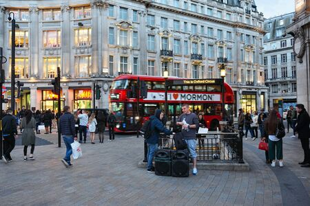 hm: LONDON, UK - APRIL 23, 2016: People shop at Oxford Circus in London. Oxford Street has approximately half a million daily visitors and 320 stores.