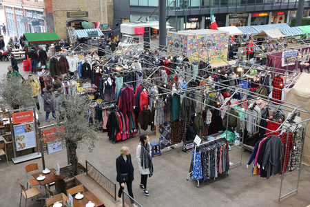 existed: LONDON, UK - APRIL 22, 2016: People shop at Old Spitalfields Market in London. A market existed here for at least 350 years.