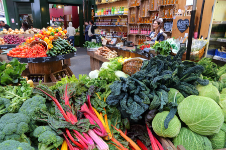 southwark: LONDON, UK - APRIL 22, 2016: People shop at Borough Market in Southwark, London. It is one of oldest markets in Europe. Its 1,000th birthday was in 2014.
