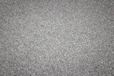 blacktop: Asphalt concrete roadway pavement surface. Grey background.