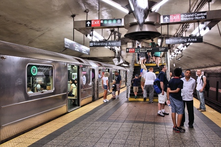 NEW YORK, USA - JULY 3, 2013: People visit a subway station in New York. With 1.67 billion annual rides, New York City Subway is the 7th busiest metro system in the world.