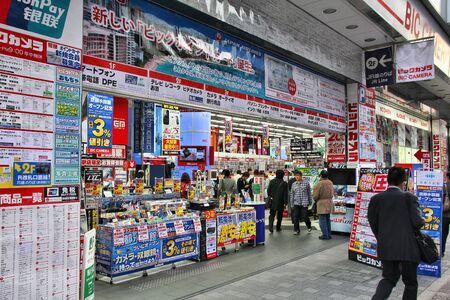 net income: KYOTO, JAPAN - APRIL 18, 2012: Customers enter Bic Camera in Kyoto, Japan. Bic Camera group had 9.049 billion yen net income in 2011 and is one of largest electronics retail chains in Japan.