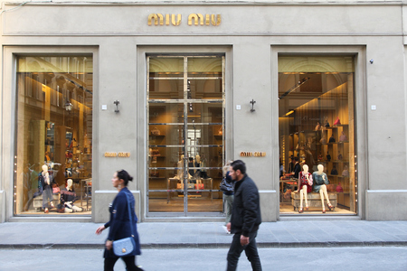 prada: FLORENCE, ITALY - APRIL 30, 2015: People shop at Miu Miu fashion store in Florence. Miu Miu is a part of Prada, company with 3.6 billion EUR of annual revenue (2013).