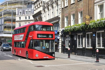 double decker: LONDON, UK - APRIL 23, 2016: People ride New Routemaster bus in City of London. The hybrid diesel-electric bus is a new, modern version of iconic double decker.